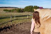 Girl leading her horse — Stock Photo