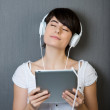Young woman enjoying her music — Stock Photo #26334335