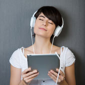 Young woman enjoying her music — Stock Photo