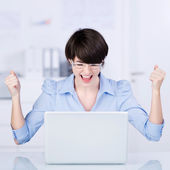 Excited businesswoman rejoicing — Stock Photo