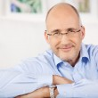 Smiling man indoors — Stock Photo