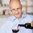 Pouring red wine into a glass — Stock Photo