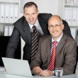 Two businessmen in an office — Stock Photo