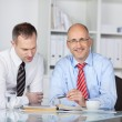 Two businessmen at desk — Stock Photo