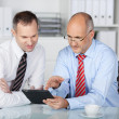 Stock Photo: Businesspeople with digital tablet