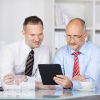 Businessmen with tablet computer — Stock Photo