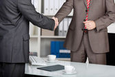 Business partner shaking hands — Stock Photo