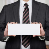 Showing a white envelope — Stock Photo