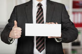 Thumbs up with envelope — Stock Photo