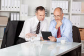 Two businesspersons with digital tablet — Stock Photo