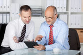 Businesspeople with digital tablet — Stock Photo