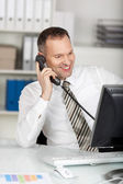 Calling businessman in office — Stock Photo