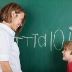 Happy little boy with his teacher — Stock Photo