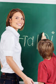 Teacher and young student — Stock Photo