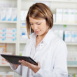 Pharmacist working with a tablet-pc — Stock Photo