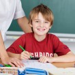 Little boy at school — Stock Photo #26440667