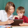 Stock Photo: Teaching with tablet