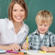Smiling educator with boy — Stock Photo