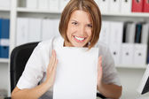 Smiling businesswoman show white paper — Stock Photo