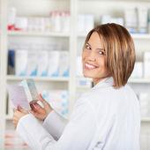 Smiling pharmacist — Stock Photo