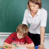 Student and teacher at school — Stock Photo