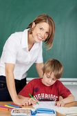 Smiling teacher and student — Stock Photo