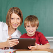 School lesson with tablet — Stock Photo