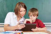 Teaching with tablet — Stock Photo