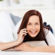 Laughing woman with a mobile — Stock Photo