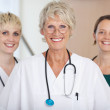 Confident Medical Team Of Female Doctors Smiling — Stock Photo