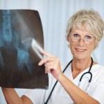 Senior Female Doctor Holding Hip Xray Report — Stock Photo