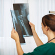 Doctor Comparing Xray Reports In Hospital — Stock Photo #26498163