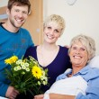 Stock Photo: Happy Children With Flower Bouquet Visiting Mother In Hospital