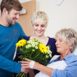 Children Giving Flower Bouquet To Mother In Hospital — Stock Photo