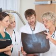 doctors discussing over xray in hospital — Stock Photo