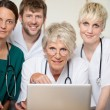 Stock Photo: Confident Doctors With Laptop In Hospital