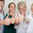 Happy Doctors Team Showing Thumbs Up — Stock Photo