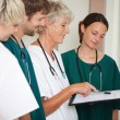 Doctors Reading Report In Hospital — Stock Photo