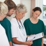 Doctor Explaining Patient Record — Stock Photo #26499167