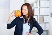 Piggybank on shoulder — Stock Photo