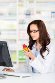 Pharmacist working on her computer — Stock Photo