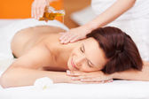 Spa beauty treatment with oil — Stock Photo
