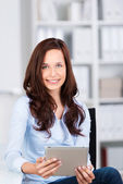 Businesswoman with a tablet-pc — Stock Photo