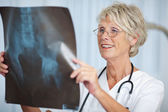 Senior Female Doctor Looking At Hip Xray Report — Stock Photo