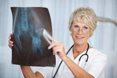 Senior Female Doctor Holding Hip Xray Report — Stock Photo