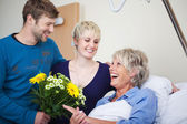 Children With Flower Bouquet Visiting Happy Mother In Hospital — Stock Photo