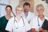 Doctors Team Smiling Together in hospital — Stock Photo