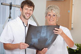 Male And Female Doctors Holding Xray Report — Stock Photo