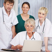 Doctors With Laptop At Desk In Hospital — Stock Photo