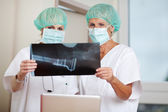 Surgeons Looking At Xray In Clinic — Stock Photo